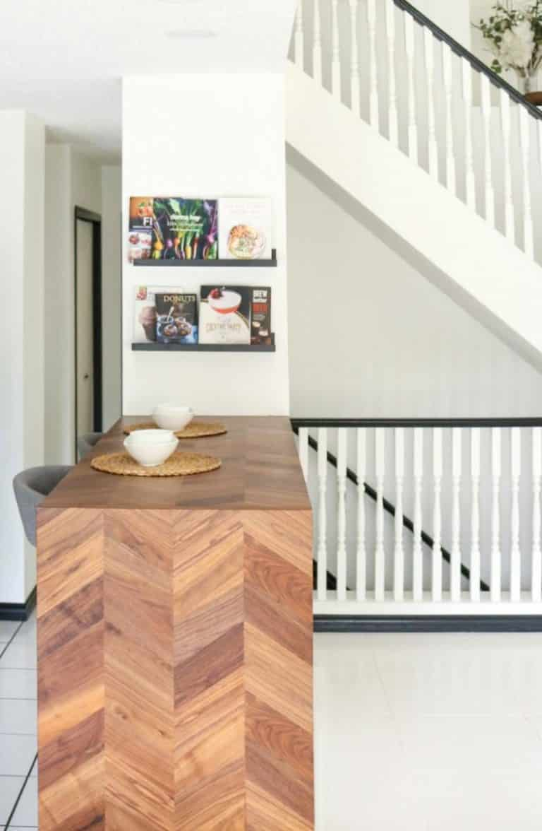 Art-deco meets eclectic and transitional style eating bar with chevron-pattern walnut waterfall butcher block